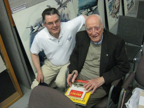 Toronto Chapter member Neil McGavock showed up at the meeting to have his treasured Fred Hotson books The Bremen and De Havilland in Canada autographed by the renowned author himself. (Larry Milberry)