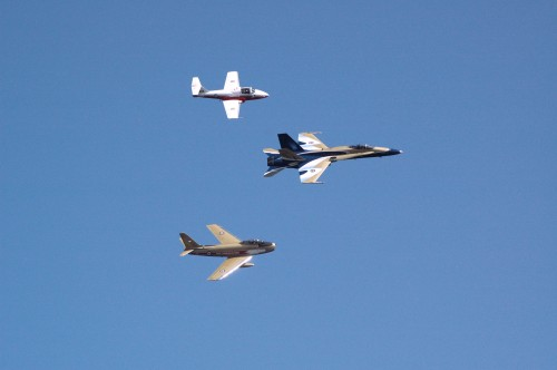 The Vintage Wings Sabre formates with the Centennial of Flight CF-18 and a Snowbird Tutor at Comox on April 25, 2009.