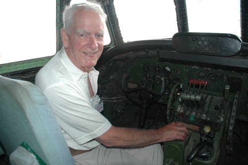 "Bob Bogash at the captain's helm of the Super Connie that he saved from the the junk yard. Notice all the 1950s ""switchology"" and the Super Connie's ""steam-powered"" instrument panel. (Ken Swartz)"