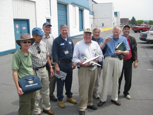 Some of the tailgating gang in EAC's parking lot: Ron Rhodes, Jay Fancott, Homer Campbell, Kevin Lacey, Bob Bogash, Clint Ward, Dave Robertson and Ken Swartz. Note Ron's original TCA carry-on bag and the original TCA Super Connie model that Bob is holding. Dave holds a Super Connie technical manual -- he donated both model and manual to the CF-TGE cause. (Larry Milberry)