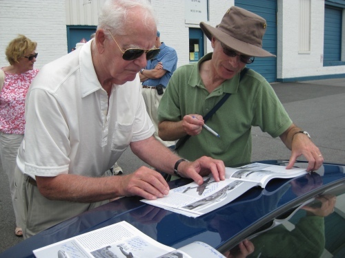 Ron Rhodes grabs Don Cameron to autograph his copy of The Wilf White Propliner Collection, which features CF-TGE on the cover. (Larry Milberry)