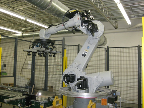 Friesen Robot ... No surprise that robotics play an important role at Friesen Printers. This Motoman HP165 specializes in picking boxes of books off the end of the bindery and stacking them on pallets for shipment.