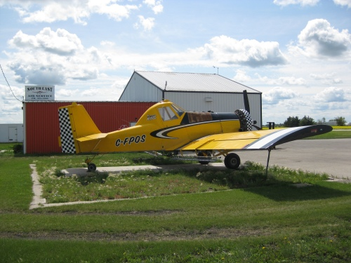"""Besides all the work at Friesen, I made my usual visit to the Altona airstrip to check out the action. Lovely day that it was, all was quiet. However, there was an eye-catching Rockwell Commander S-2R that I hadn't seen before at Southeast Air Service. C-FPOS """"Reno Ripoff"""" (c/n1777R) looked just fine under Manitoba sun and sky. Sad to say, but time was short and I hadn't a chance to visit Arty's """"ag"""" operation at Winkler, not even Peter Funk's at Morris, en route back to Winnipeg. Oh well, maybe next year.   There can be the odd snag on an outing like this, sometimes one that can really cheese a fellow off. What was it this time? One word -- Budget. To be sure of smooth sailing all the way, I had web-booked a rental with Budget. How smart is that, I figured! Well, not so smart, so renters beware of YWG Budget."""