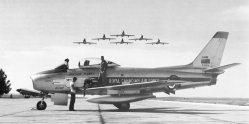 """The idea for the """"set up"""" at Downsview was inspired by this famous Golden Hawks scene, shot by the RCAF at Calgary in July 1960. You can see the drama in this view -- the lower the formation, the more exciting the photo. But you can't always have it your way when you're behind the lens. Someone else is calling other shots, but do the best with what you get and hope for a bit of luck."""