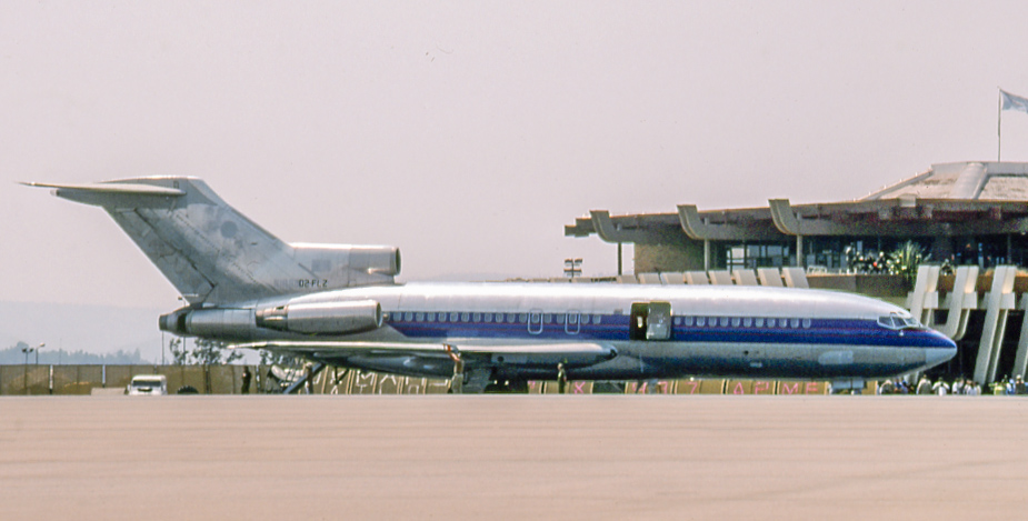 Angolan 727 D2-FLZ at Kigali, Rwanda on August 3, 1994. This 727-542 had begun in 1968 as N1965 of American Airlines, where it worked into 1993. It last was heard of as TN-AFZ with Trans Air Congo in the early 2000s. D2-FLZ worked for the nefarious South African/Angolan mercenary outfit Executive Outcomes, which specialized in brute force regime changes.