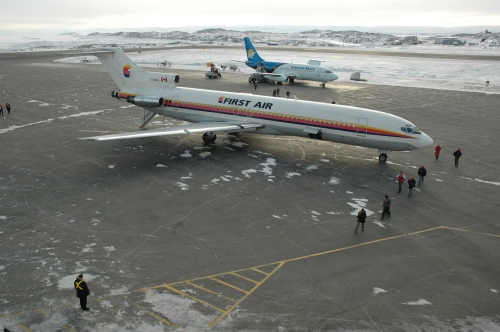 "First Air 727 C-GXFA approaches to land at YFB Iqaluit on a clear day in February 2006. Then, ""XFA"" is seen from the control tower as the passengers deplane. From 1975-90 ""XFA"" had been Air Canada C-GAAG, then it was with Air Transat 'til joining First Air in 1994. In about 2008 ""XFA"" went into long-term storage at Trois-Rivieres."