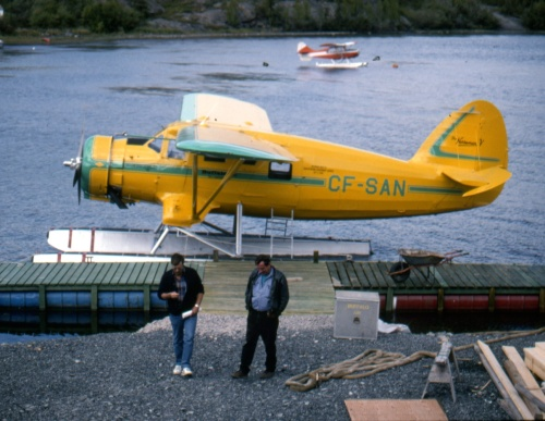 """In the early 1990s Joe McBryan of Buffalo Airways restored CF-SAN. Having begun with Saskatchewan Government Airways in 1946, """"SAN"""" later served a long list of operators, until grounded by an accident at Fort Simpson in 1981. Years later Joe acquired the wreck, had it restored to perfection, then re-introduced it at the Norseman Festival in Red Lake in July 1995. Here it sits in Yellowknife the following month."""