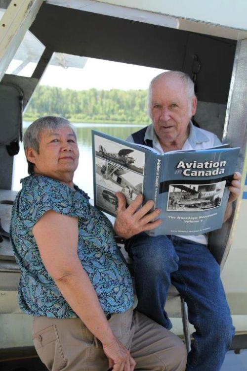 Eleanor & Gord Hughes of Ignace checking out the book at the dock with their Norseman, which they were flying today.
