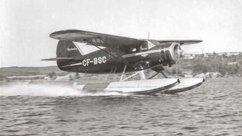 "The renowned and much covered Austin Airways Norseman CF-BSC screams down Ramsay Lake at Sudbury, Rusty Blakey at the helm. (M.L. ""Mac"" McIntyre)."