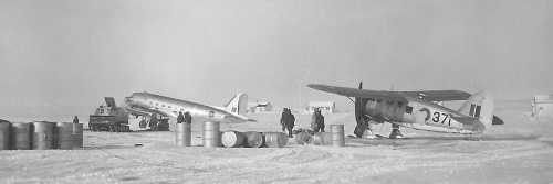 "Likely also from ""Musk Ox"" is this view of Norseman 371 with RCAF Dakota 963, location unknown. 371 previously served on wartime survey operations in the Canadian Arctic. It later was CF-ILR, the adventures of which are well covered in Norseman Vol.2 (its remains still may be seen on Baffin Island)."