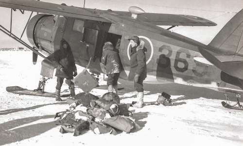 "Norseman 369 offloads somewhere in the NWT during ""Musk Ox"". For this famous northern exercise, air support was provided to the Army by a temporary RCAF organization – No.1 Air Support Unit (see Norseman Vol.1 pp 143-145). This view illustrates the Norseman's big wooden ""bear paw"" skis, which pilots did not like. (RCAF PL37690)"