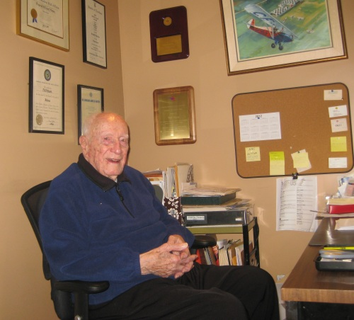 DHC author – the great Fred Hotson in his home office in Mississauga in 2012. Age 97, Fred still was busy researching and writing. On the wall is the painting Bill Wheeler did of Fred's tiny Heath homebuilt.