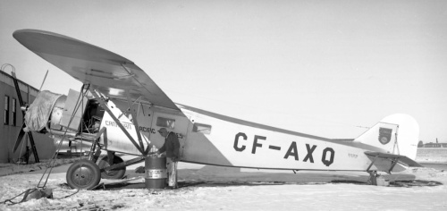 "There usually was a Fairchild 71 or an 82 any day around Edmonton from the late 1920s into the early 1960s. This lovely period view by Leslie features CPA's famous ""82"" CF-AXQ getting some daily servicing. Built in 1939 for Mackenzie Air Services of Edmonton, it migrated to CPA with that new company's takeover in the early 1940s of a host of smaller northern operators. In 1946 ""AXQ"" was acquired by Waite Fisheries of Ile-a-la-Crosse, Saskatchewan. When the pilot got into deteriorating weather on January 28, 1947, his windscreen iced up so badly that he couldn't see properly on landing, and crashed near home base. In our junior days of shooting at Malton in the 1950s we'd have been happy with the lighting here, but would likely have passed on even taking a shot ""for the record"" due to the gas drum, tie–down ropes, engine cover, open cockpit door , ladder in the background and, horror of horrors, that fellow standing there. How pitiful, eh, to be missing out on such fundamentals of a true aviation scene."