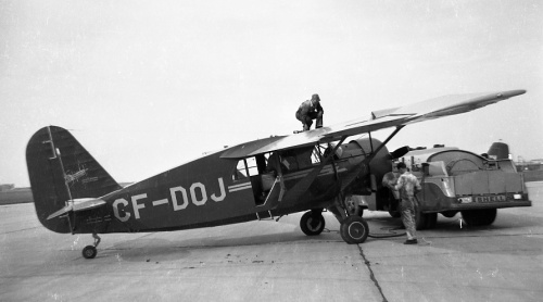 "A newly built Northwest Industries Bellanca 31-55 Senior Skyrocket (600 hp PW R-1340) at Edmonton circa 1947. Prototype CF-DCH had flown on February 28, 1946, but only 13 examples were manufactured. The ""31-55"" had little hope in the market of competing again cheap war surplus Norsemans, then the Beaver came along to seal its fate. This is a really typical Corness photo, capturing as it does some interesting features, especially the nifty Shell fuel truck."