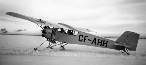 "Besides frequent and ever-exciting visitors, Edmonton was home to dozens of ordinary bushplanes that plied the Mackenzie River Valley down to the Arctic coast. The Curtiss Robin was a typical hard working northern workhorse. CF-AHH was first registered in Canada in 1929. It served various Alberta owners into 1946, when it migrated to Hudson, Ontario to fly with the famous Starratt Airways. ""AHH"" last was heard of with an Air Cadet squadron in Winnipeg in 1950. Leslie caught it in this ideal view, heading out from Edmonton on skis (tail draggers tend to look especially nice in a ""rear ¾"" view). This is a typical shot by Leslie, where the day was cloudy. The result was nice even lighting with no harsh/distracting shadows. One of the truly delightful sources of information about any such early US-certified aircraft is the magnificent 9-volume set ""US Civil Aircraft Series"" by the incomparable Joseph P. Juptner. Fans everywhere have been leaning on Juptner for ""the good gen"" since his series first appeared in 1966. Any serious fan needs these books."