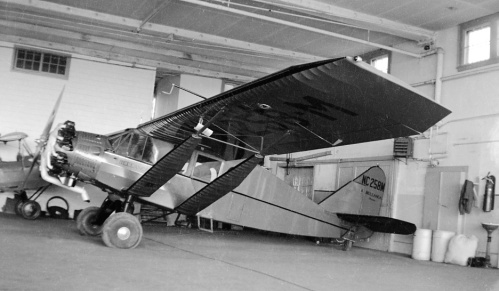 A plane sitting in the corner of a hangar at Edmonton was as inviting to Leslie as if it were outside in the sun. Bellanca CH-300 NC258M (300 hp Wright engine) also was passing through when he shot it circa 1940.
