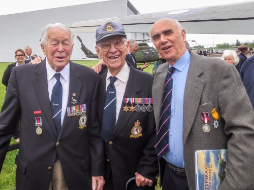 "Ken Hanna (181 Sqn) with Frank Johnson (174) and publisher Larry Milberry. Ken wears the following medals: Distinguished Flying Cross, 1939-1945 Star, Aircrew Europe Star with Clasp denoting post-D-Day service, Defence Medal, Canadian Volunteer Service Medal, War Medal 1939-45 and l'Ordre national du Quebec. Otherwise, he displays an Operation Wing, 181 Sqn crest, a Typhoon pin and (on the right) the Normandy Campaign Medal -- an honour created by a private veteran's association (people had to purchase it with proof of qualifying service). John's medals are: 1939-1945 Star, France and Germany Star (post-D-Day service), Defence Medal, Canadian Volunteer Service Medal, and War Medal 1939-45. Both the fellows sport ""Typhoon"" ties."