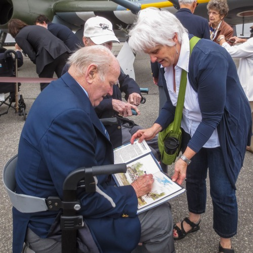 Harry Hardy autographs an admirer's copy of Hugh Halliday's renowned book.