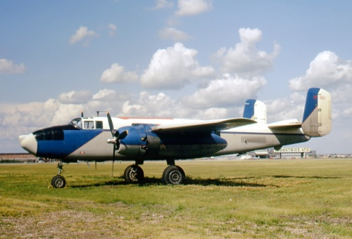 B-25 fuel hauler CF-DKU of Aurora Aviation as photographed by Leslie Corness at Edmonton Industrial Airport on July 18, 1973.