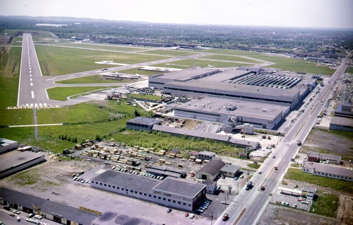 "the C-5 are related in CANAV's classic title The Canadair North Star. Canadair 19 A view of Cartierville looking northwest with St. Laurent Blvd going off toward to right (north). The main plant was built during the war for PBY-5 production, then was converted in 1945 to build North Stars. This view is circa 1960 -- the CL-44 and CL-66 (Convair 540) era. Across the field is the old Noorduyn Norseman factory, where Harvards and Norsemans were built, then T-33s, Sabres, CF-5s, CL-41s and F-104s in the 1950s-60s. Many more details of this historic landscape are recorded in Canadair: The First 50 Years, The Canadair North Star and Air Transport in Canada. Today, Cartierville airport is gone, replaced by residential neighbourhoods. However, the main plant, where Bombardier still manufactures aircraft structures, survives. For more about the DC-3 in Canada, scroll back and enjoy ""Where are They Now? Canada's Enduring DC-3s""."