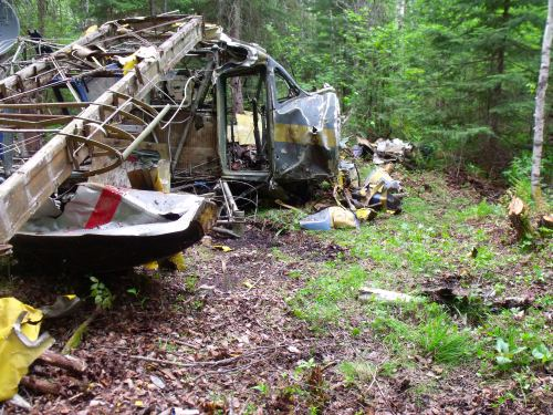 The main wreckage of CF-MPL after the fuselage was righted and the starboard wing raised out of the muck. Note how the standard RCMP colour scheme still was in use in Percy Bradley's time.