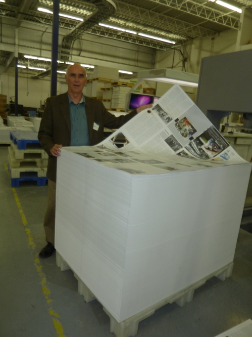 The publisher stands by a pallet with about 2200 sheets. Then, the pallet is flipped by a specialized gizmo, so the backside can be run through the press with yet another 16 pages of CAE history.