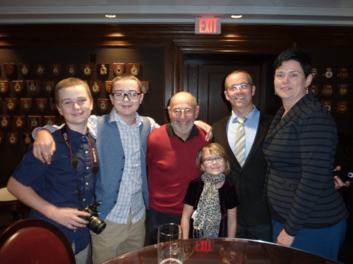 Key family members throwing in their support at the book launch: Milberrys Foster, Owen, Marin, Simon and Amanda with U of T staff alumnus Dr. Jack Pitre in the red sweater.