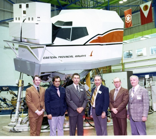 CAE and Eastern Provincial Airways staff with the new EPA 737 flight simulator at the factory early in 1976 during final approval and acceptance. (Ed Bermingham)