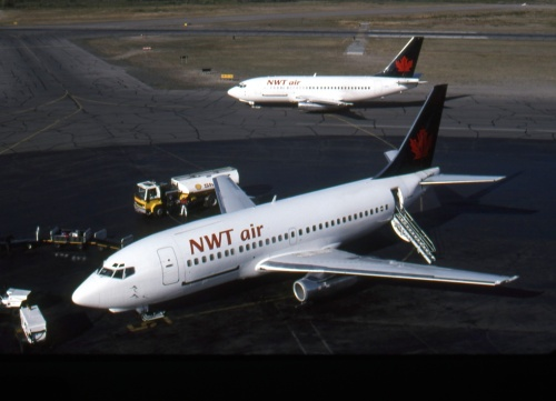 NWT eventually was sold to Air Canada, so adopted the new owner's fleet colours. These NWT Air 737-200s were  at Yellowknife on August 18, 1995 (C-GNWN nearest).
