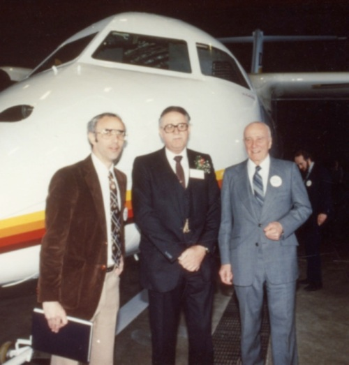 Publisher Milberry, DHC President Sandford and author Hotson at the Dash 8 rollout. The Dash 8 and the DHC book developed simultaneously and rolled out together on April 19, 1983. Plane and book are still going strong.