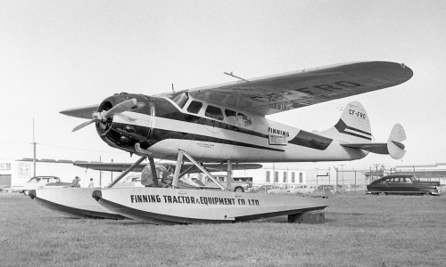"Cessna got off to a strong postwar start with its 2-seat Ce.120/140 personal planes and trainers, and glitzy Ce.170 and 190/195 4/5-seaters. The 1948 Ce.170 had an all-metal fuselage with fabric-covered, metal-framed wing and tail. Fabric was traditional and practical enough, but buyers now were eyeing all-metal construction, where Beech was excelling. Cessna closed the gap in 1949 with the all-metal Ce.170A, then the Ce.170B with improved wing/flaps. But these aircraft all were tail draggers, while the Bonanza had begun futuristically (as far as personal light planes then went) with a steerable nose wheel. Ultimately, in 1956 Cessna brought out its nose wheel ""172"". Cessna turned out more than 5000 Ce.170s plus some 1200 of its higher-end, Ce.190/195s, introduced in 1947 at $12,750. Shown is Cessna 170B CF-HVY departing the Oshawa Breakfast Fly-In on June 16, 1963. Richard Pagani of Guelph owned ""HVY"" at this time. Ce.195B CF-FRO is seen at Vancouver on September 25, 1956. Following an accident of October 23, 1972, when it was owned by Gary Bell of White Rock, BC, ""FRO"" was sold to Robert Payne of Kent, Washington. The last heard of ""FRO"" was a 1996 notice in the Ce.195 club newsletter that a few of its bits and pieces were for sale. Parked behind and to the right of ""FRO"" in this fine view is a 1951 Nash Ambassador. (Larry Milberry, Al Martin)"
