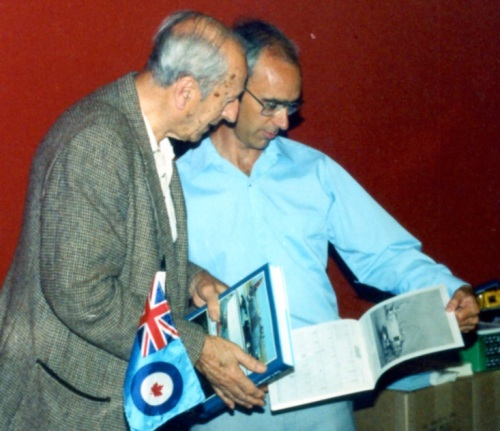 The author looks over some Sabre photos with Max Nerriere, one of the pioneers of the Orenda 14 that powered the Sabre VI. Max later was helped maintain the large fleet of ex-Luftwaffe Sabres that Pakistan clandestinely acquired.