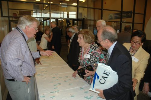 : The Prestige Club's Mike Cregan (left) works the registration table at CAE on May 26. Long a devotee of CAE heritage, Mike was an invaluable part of CANAV's push to produce its landmark history of CAE.