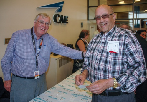 Mike Cregan greets Bob Barnard, two key supporters when it came to various historical topics and fact checking as the CAE book. Bob joined CAE from the RCAF in 1960, his first of many projects being the Argus Tactical Crew Procedures Trainer. The TCPT now is on display in the museum as RCAF Station Greenwood.