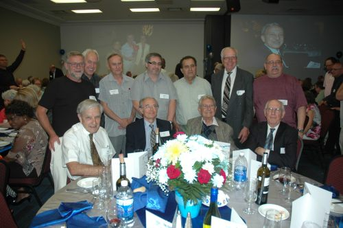 One of the 40 or so tables at this year's Prestige Club gathering included (seated) company pioneers Bob Kemerer, Jack Shlien, Byron Cavadias and Gilles Sevingy.