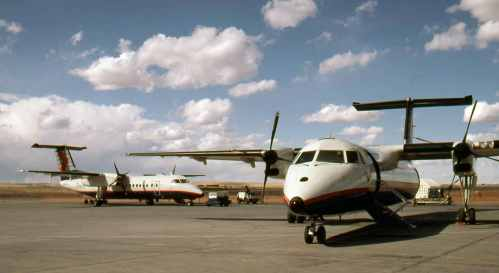 Dash 8 No.5 A pair pf TimeAir Dash 8s at Calgary April 7, 1991
